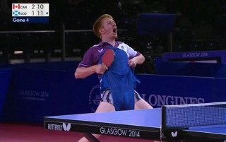Celebration: Table tennis player Gavin Rumgay pulled up his shorts and showed off his pants after winning a cruical point during his enounter Canada's Pierre-Luc Theriault